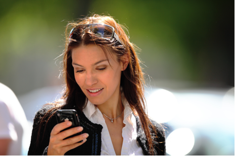 Photo of a woman using a mobile device.